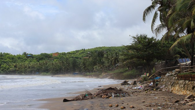 Trash laying around the Kudle Beach in Gokarna outside the tourist season