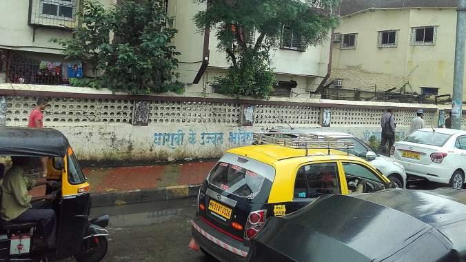 Taxis and rickshaws in a traffic jam in Mumbai.