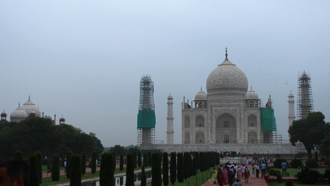 Alternative pictures from Taj Mahal: Here's the mausoleum on a cloudy morning with the front towers under renovation.