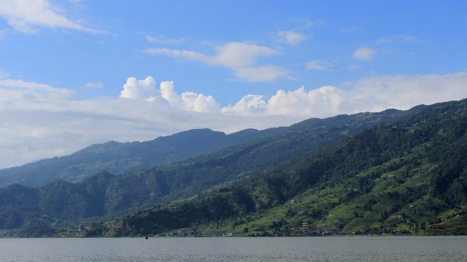 The peak of Annapurna South as seen from a boat in Phewa Lake Pokhara.