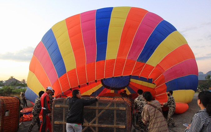 Inflating hot air balloon in the airport of Vang Vien, Laos.