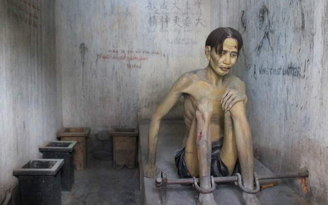 A dummy war prisoner in a reconstruct American prison room from Vietnam War era.