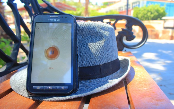 Headspace Android app and a hat on a bench in Mexico.