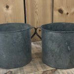 A matching pair of Vintage Galvanised Metal Pots . In Camberley Surrey These containers make fantastic planters and could be used for kindling or as a little bin etc.