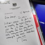 A detail of a declassified handwritten letter sent by former British Prime Minister Tony Blair, to former US President George Bush, is seen as part of the Iraq Inquiry Report presented by its Chairman Sir John Chilcot, at the QEII Centre in London on July 6, 2016. Former British prime minister Tony Blair took his country into a badly planned, woefully executed and legally questionable war in Iraq in 2003, according to the findings of a long-delayed inquiry into Britain's role in the conflict. The Chilcot report found the decision to join the US-led invasion was taken before all other options had been exhausted and on the basis of false intelligence. / AFP PHOTO / Jeff J Mitchell