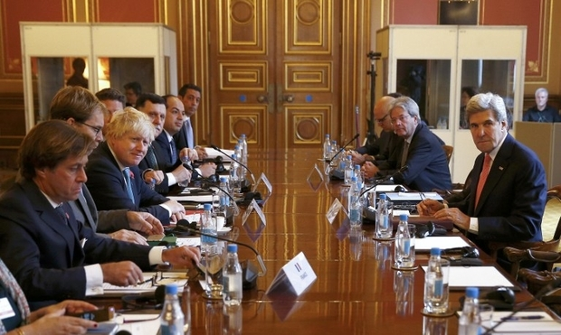 US Secretary of State John Kerry (R) attends the Libyan Ministerial meeting with Britain's Foreign Secretary Boris Johnson (3L), French Foreign Ministry's political director Nicolas de Riviere (L), Italian Foreign Minister Paolo Gentiloni (2R), Libya's Prime Minister Fayez al-Sarraj (5L) and Libya's Deputy Prime Minister Ahmed Maiteeq (6L) at the Foreign and Commonwealth Office in London on October 31, 2016.  Kerry travelled to London to discuss the situation in Libya and ways to improve support for the Government of National Accord with international counterparts.  During the visit he is also set to accept two awards: the Benjamin Franklin House Medal for Leadership and the Chatham House Prize. / AFP PHOTO / POOL / PETER NICHOLLS