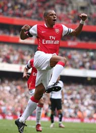 Gilberto celebrates after finishing off Fulham