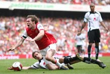 Hleb is fouled in the area