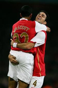 Fabregas and Walcott celebrate
