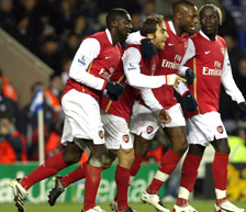The players celebrate Flamini's opener