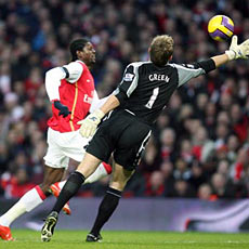Adebayor rounds goalkeeper Green to net against West Ham on New Year's Day