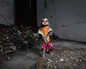 Between 2009 and 2013, numerous little monkeys dressed in baby clothes and masks with doll heads haunted the streets of Jakarta.