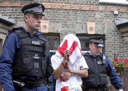 Banksy, AKA Paul Horner, seen here being taken into police custody.(AP Photo/Dennis System)
