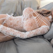 Realistic sex doll laying on bed