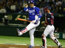 South Korea's designated hitter Lee Dae-ho reacts after getting struck out in front of USA catcher Dan Rohlfing during the fourth inning of their final game at the Premier12 world baseball tournament at Tokyo Dome in Tokyo, Saturday, Nov. 21, 2015. (AP Photo/Toru Takahashi)  (Toru Takahashi / AP)