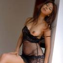 Asian hottie posing in transparent dress