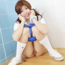 Redheaded japanese girl with very shaved pussy in white socks