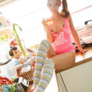 Japanese doll with sporty body at home