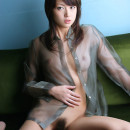 Nice asian girl posing at room and bath in transparent dress