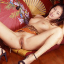 Asian with blonde pussy plays with dildo in japanese style room