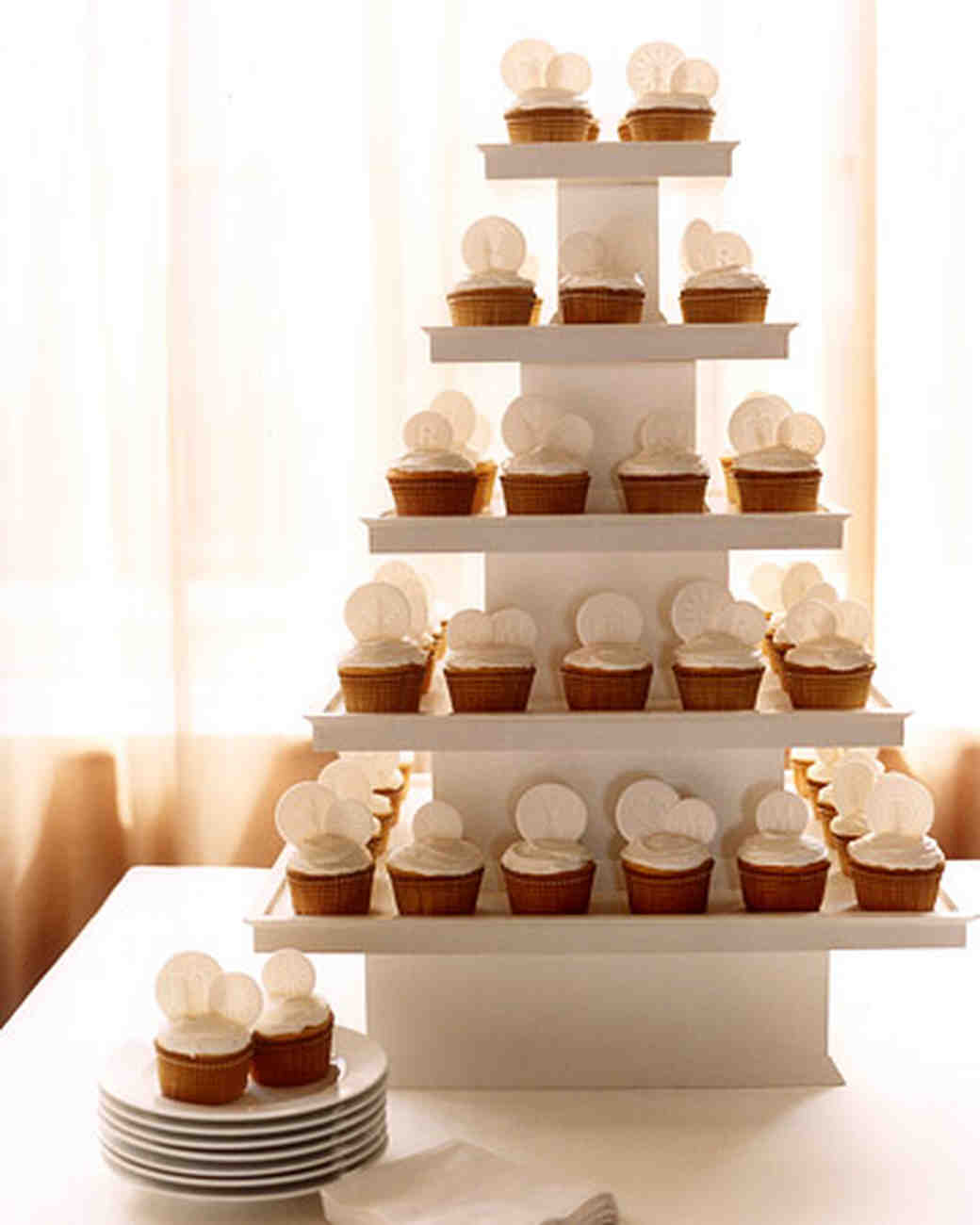 Stylish Wedding Cupcake Ideas Martha Stewart Weddings Cupcake Wedding Cakes Beach Med Cupcake Wedding Cake Dress wedding cake Cupcake Wedding Cake