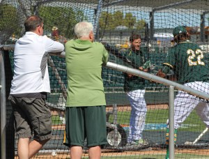 David Forst and Lew Wolff watching Josh Reddick's batting practice.