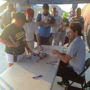 Barry Zito signing autographs on Barry Zito bobblehead day at First Tennessee Park in Nashville on Monday (photo: Nashville Sounds)