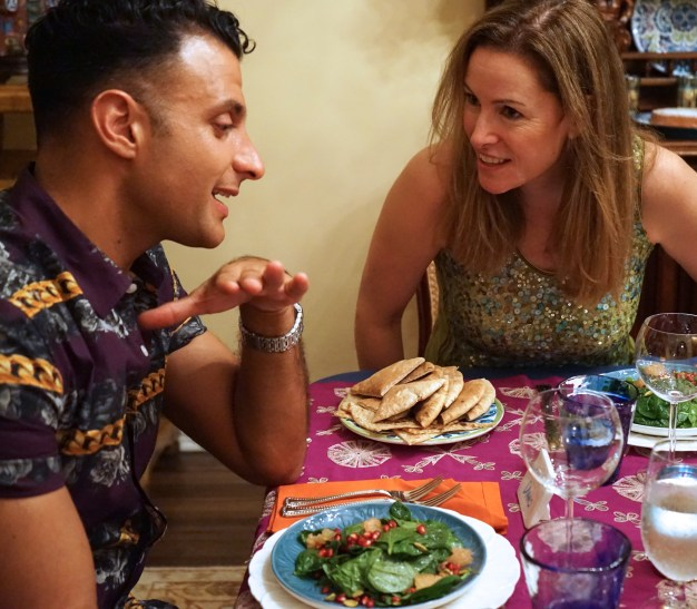 At the Moroccan Feast, Dano and Leslie talk nutrition and horoscopes. Or, are they planning to save the world?
