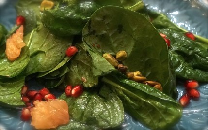 Toss greens with dressing. Add pomegranate seeds and toss until evenly distributed.