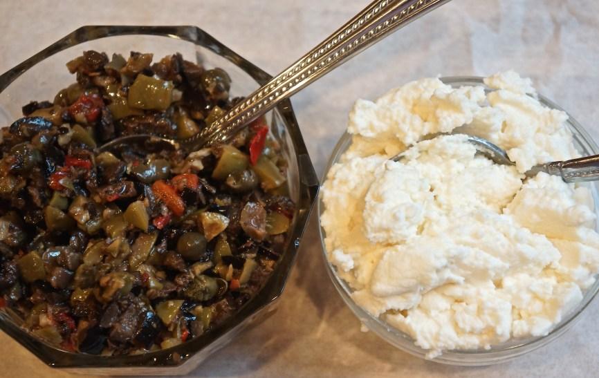 In bowl of a food processor, pulse the olives, garlic, lemon juice, lemon zest, and olive oil into a coarse paste.