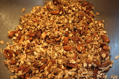 Add almonds, pecans, coconut and rolled oats and mix until everything is well coated with the almond butter / oil mixture.