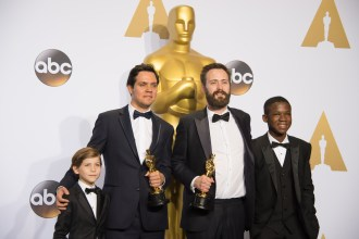 """Shan Christopher Ogilvie and Benjamin Cleary pose backstage with the Oscar® for Best live action short film, for work on """"Stutterer"""" with Jacob Tremblay and Abraham Attah during the live ABC Telecast of The 88th Oscars® at the Dolby® Theatre in Hollywood, CA on Sunday, February 28, 2016."""