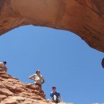 My brothers and dad standing in one of the arches at Double Arch