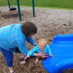 Ellen practicing her slide ninja moves. Luckily grandma Glenna was there to catch her.