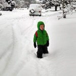 Cooper trudging through the snow to go to school.