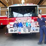 Cooper and his buddies hanging out on a fire truck.