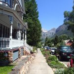Telluride's cute houses and a waterfall in the distance.