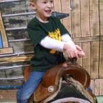 Cowboy Cooper riding his horse.