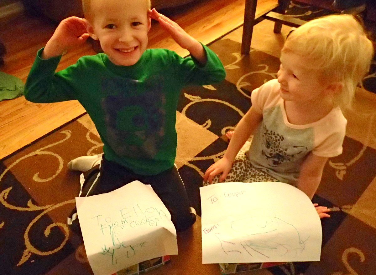 The kids excited to open their gifts from each other on Christmas Eve.