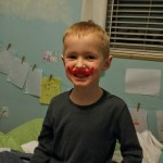 Wearing the mustache from a Valentine with his mustache pajamas.