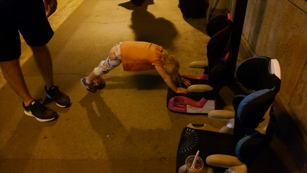 Ellen planking while we waited for our delayed train.