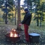 Noel warming himself by the fire.