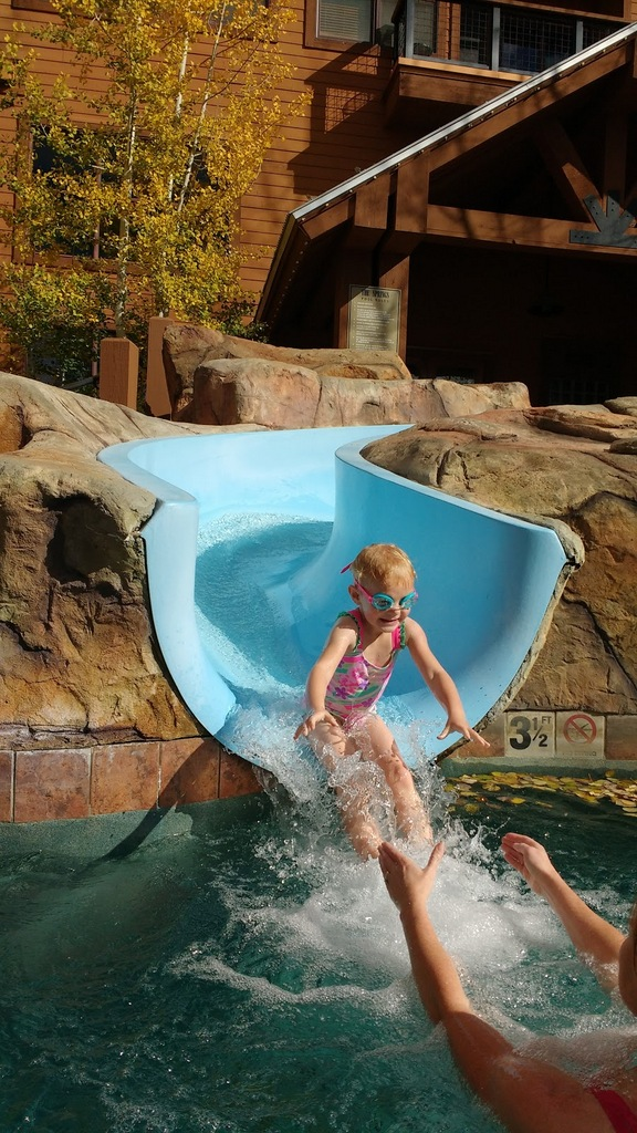 We went to the cool pool. Ellen was a slide enthusiast.