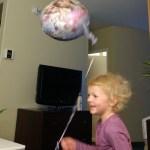 Running around with her Frozen balloon.