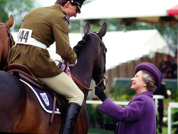Queen Elizabeth II hands out prizes to riders at The Royal Windsor Horse Show, 1991. Image Source: Tim Graham / Getty Images.