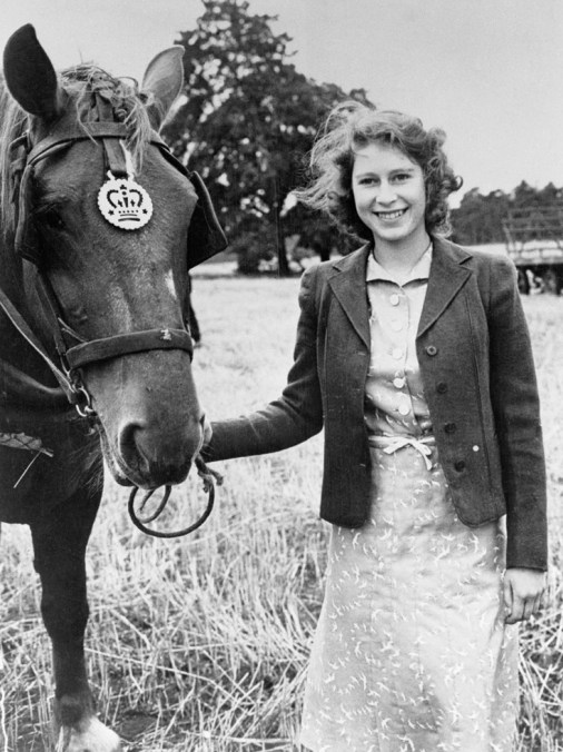 Young Princess Elizabeth, beaming a happy smile. Image Source: Found via The Horse Rider's Journal.com. Original source unknown.
