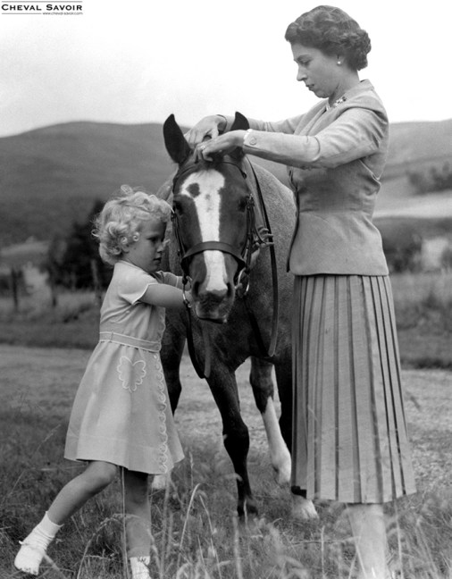 The Queen selects a pony from the meadow at Balmoral with her daughter, Princess Anne, 1955. Image Source: © Ph. Archives. DR