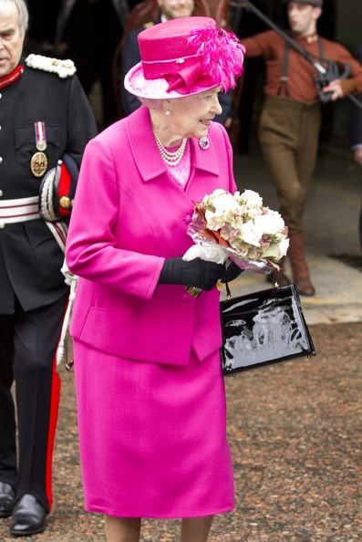 Queen Elizabeth visits the National Theatre to commemorate the institution's 50th anniversary on October 22, 2013 in London, England. / Source: Bauer Griffin
