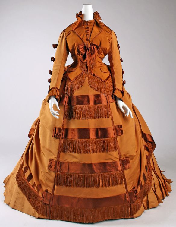 Day Dress dated 1867-1871. Designed by Depret (French). Finely crafted of pumpkin orange silk. / Source: MET Museum.