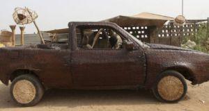 wicker-covered car by ojo obaniyi 1